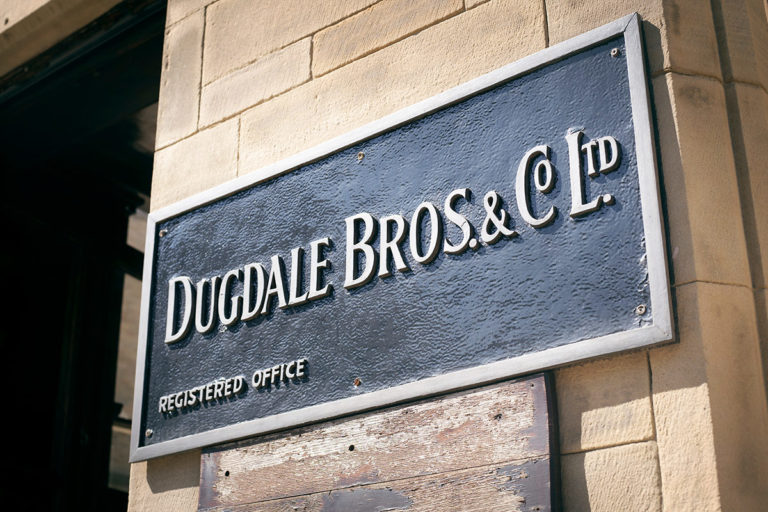 Dugdale Bros and Co building sign