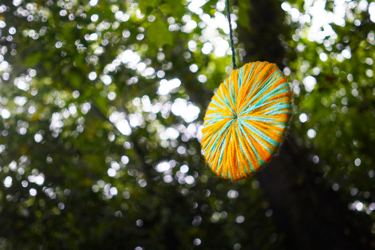Fabric disc hanging in tree