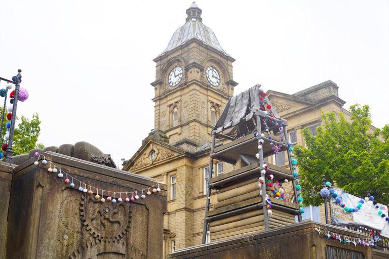 Pom poms hung on buildings in Batley