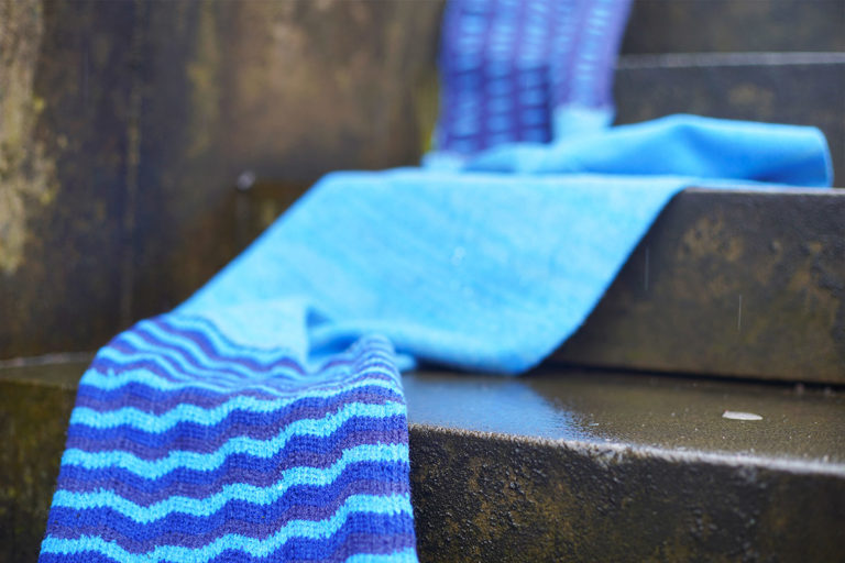 Long blue scarf flowing down outdoor steps