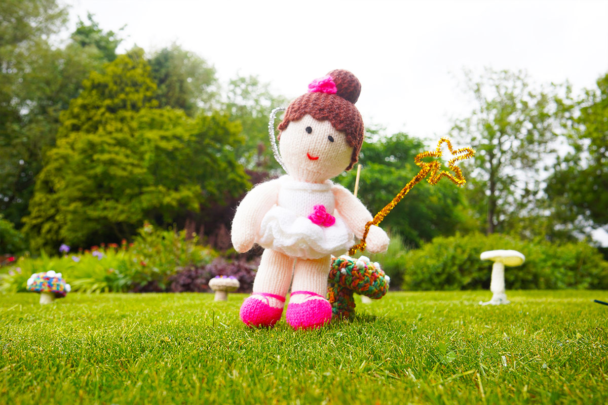 Knitted fairy in grass