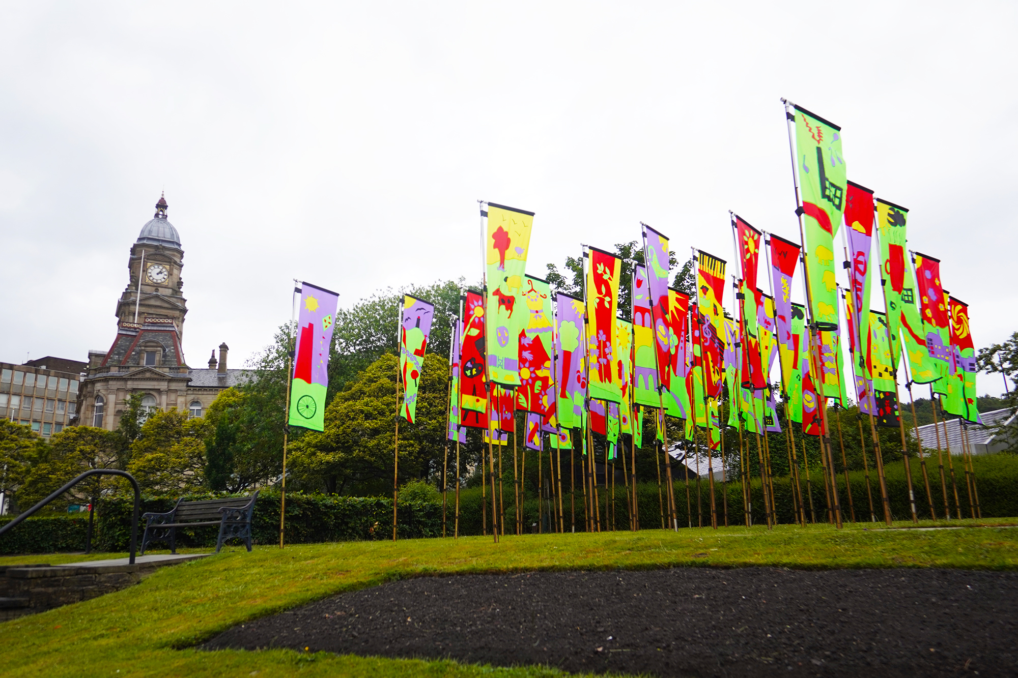 Brightly coloured flags outside Dewsbury Town Hall