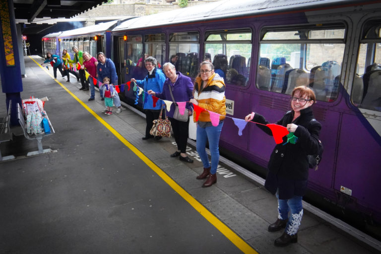 Participants on the knit and natter train holding their length of bunting