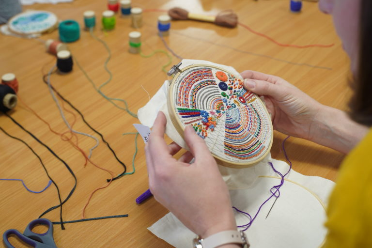 Participant at embroidery workshop- hands and embroidery hoop only