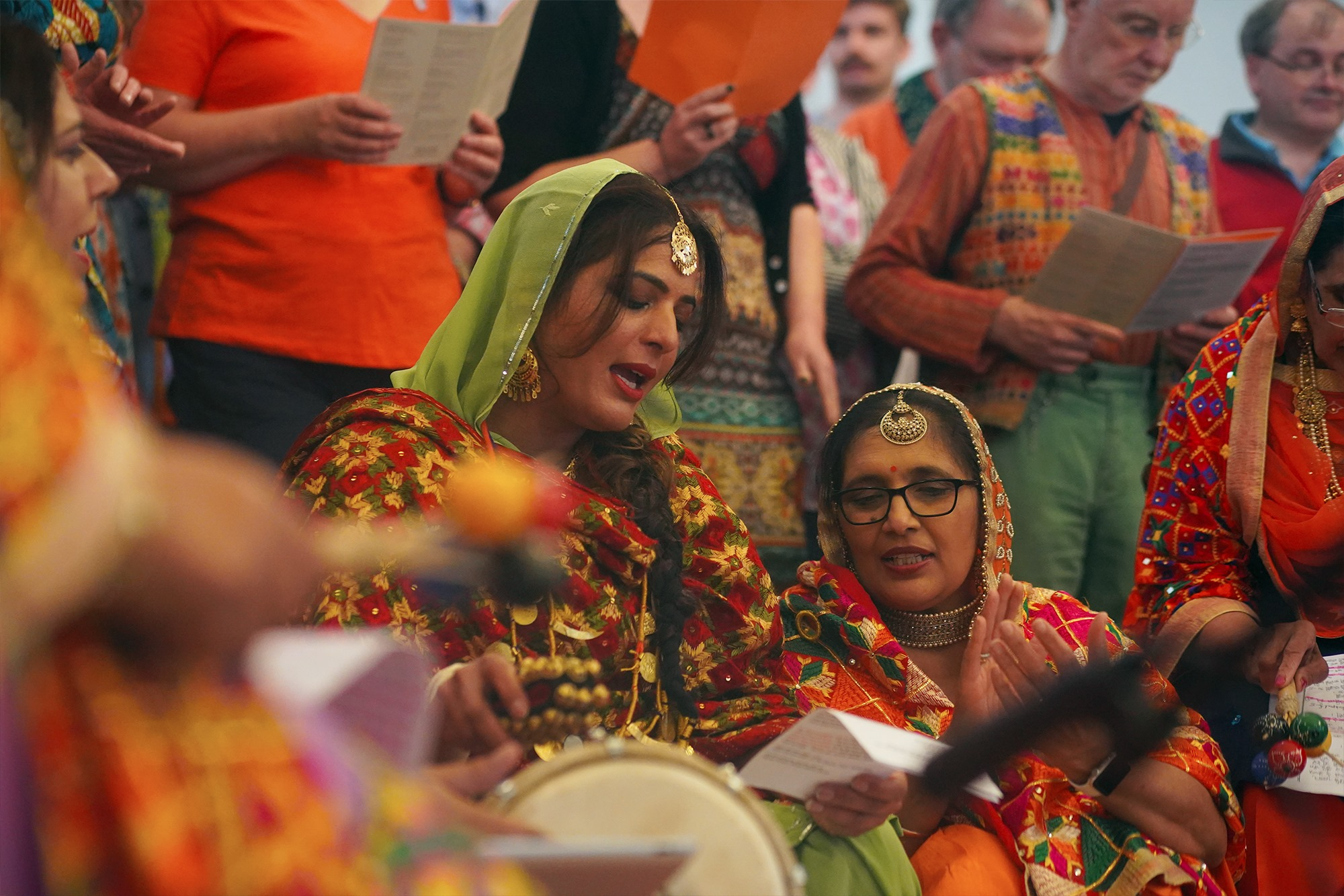 Close up of two boliyan singers at Woven Into Song performance