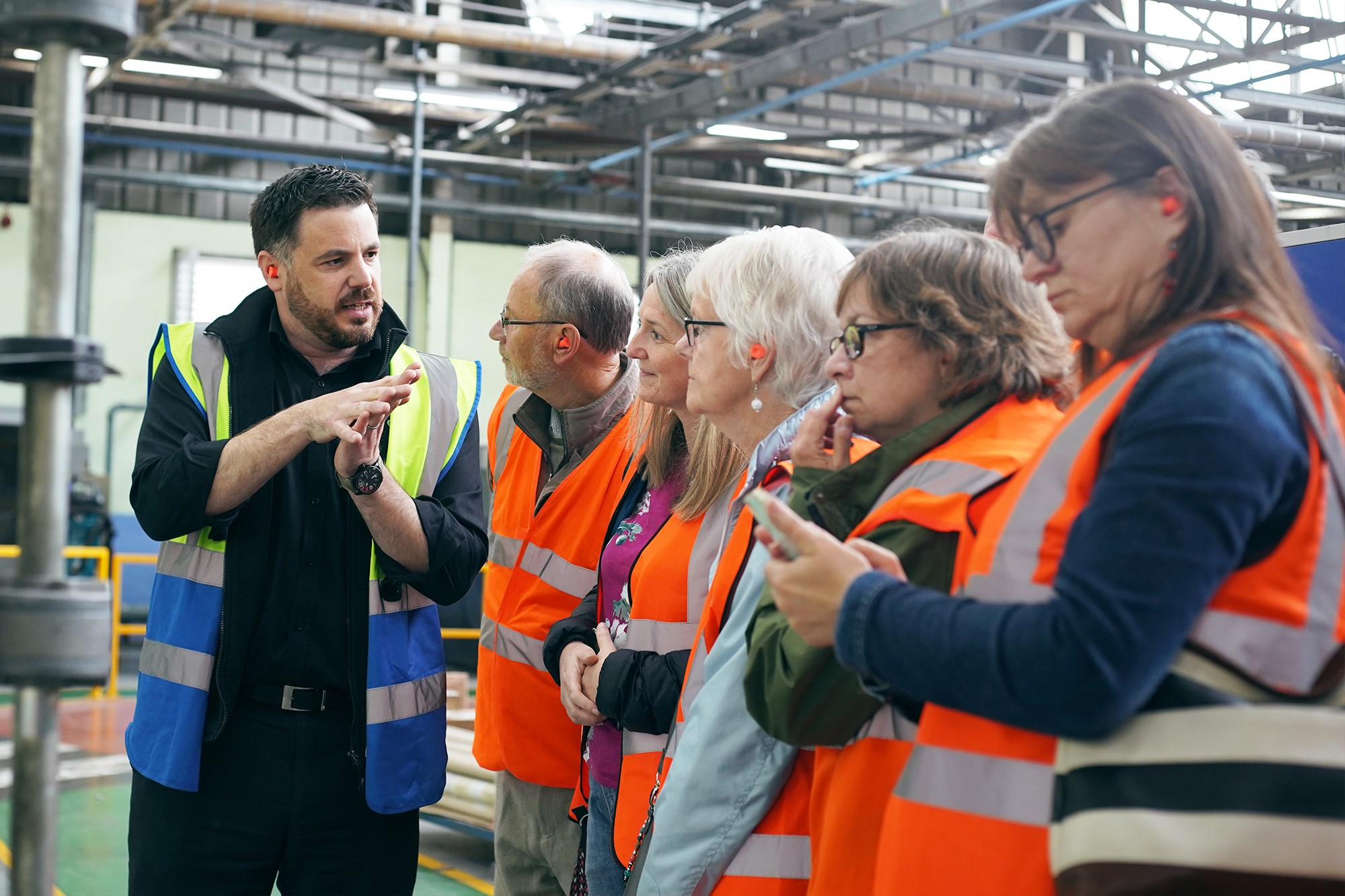 A group tour the factory at Camira