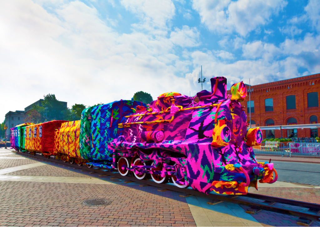 Yarn bombed train in bright dazzle colours