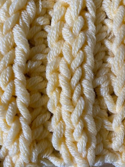 close up of finger knitting sample