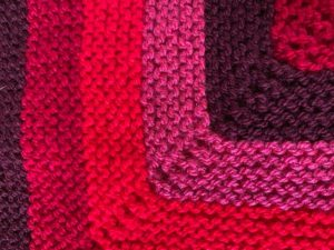 colourful knitted square close up