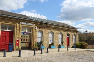 the front of batley train station with bollards and 4 arched windows
