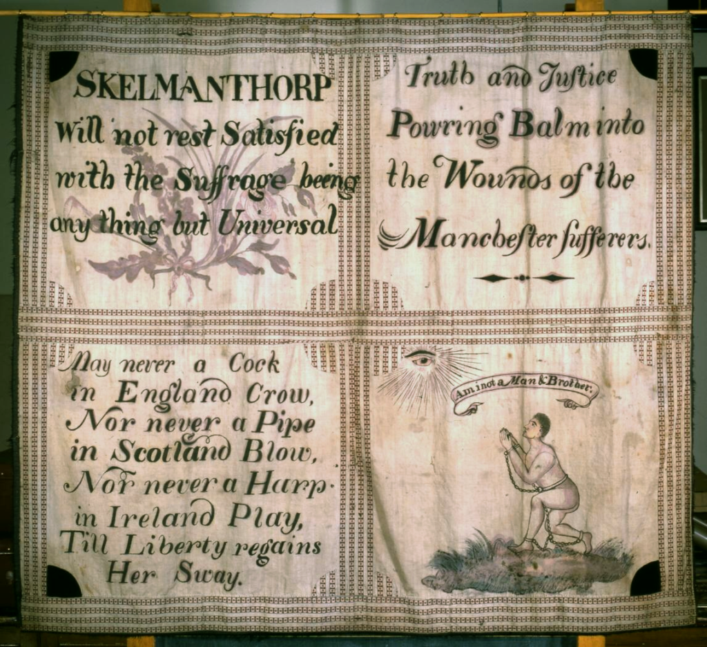 Skelmanthorpe Flag close up showing four panels with embroidered images and writing